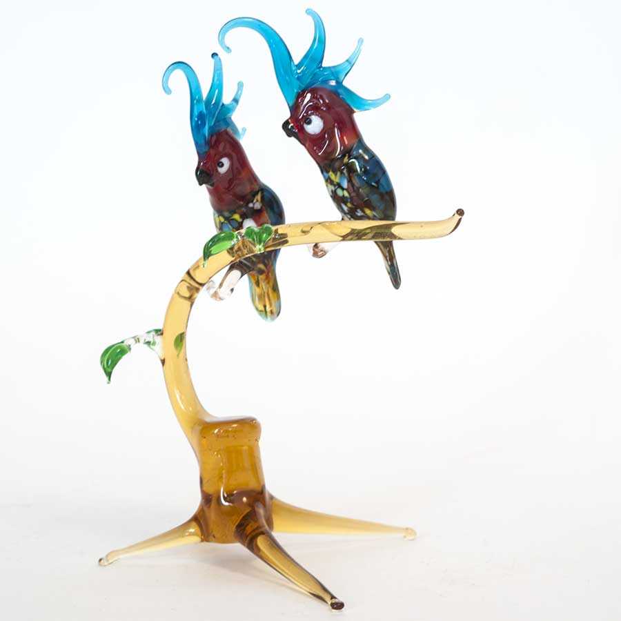 Two Parrots on the Twig